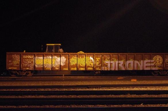 Graffiti-covered gondola railroad car