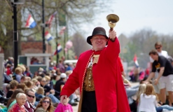 The Town Cryer leading the Tulip Time Parade