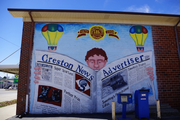 Mural on the side of the local newspaper publishing building painted by the SWCC Art Club.